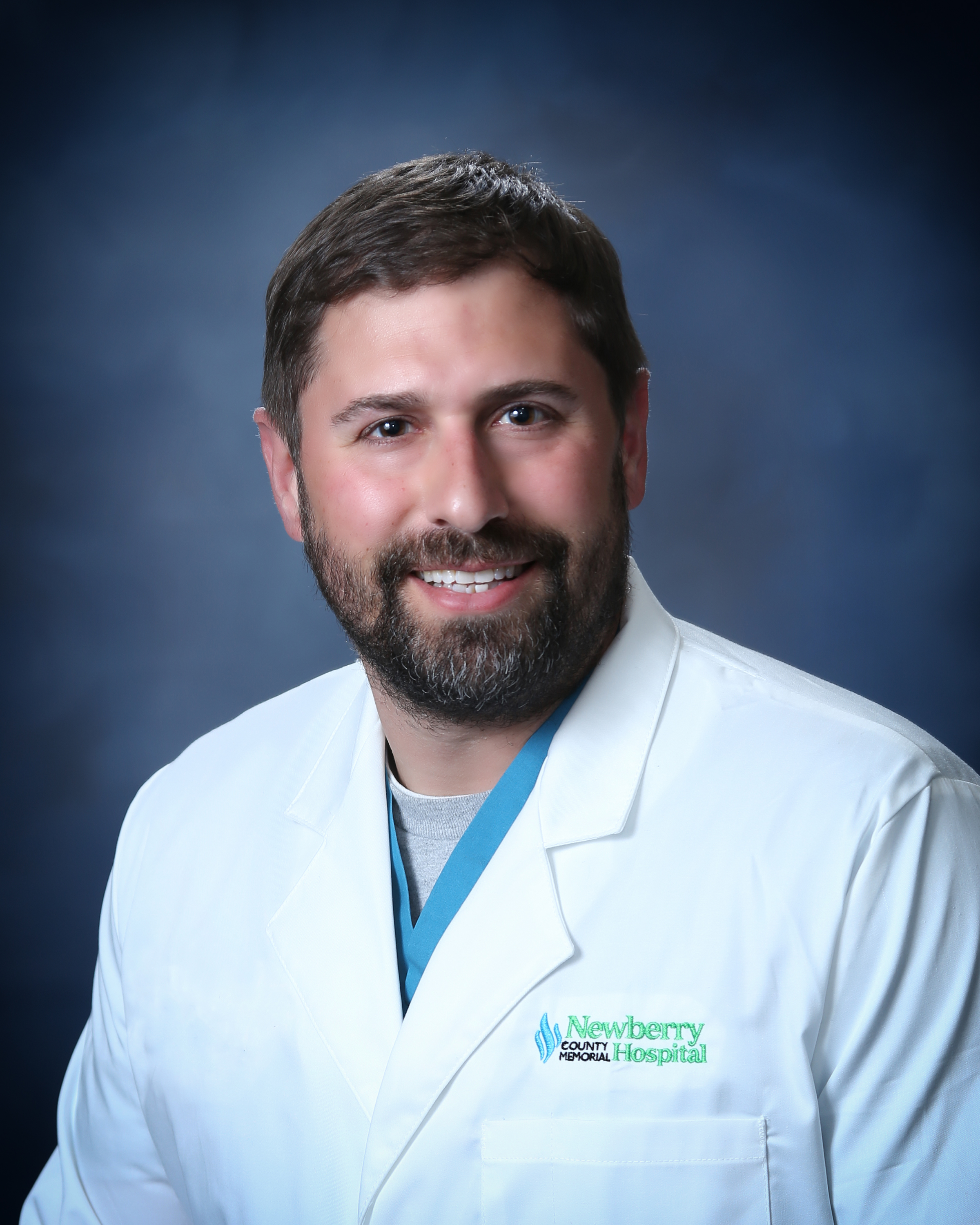 Bearded Dr. In Lab Coat Smiling